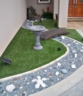 synthetic lawn turf with faux river and bridge