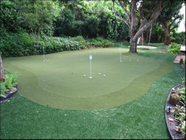 fake grass putting green with sand trap