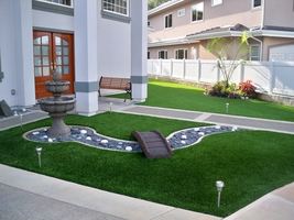 landscaped Synthetic lawn with bridge